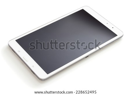 Digital tablet with the blank screen lying on a white table