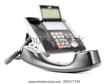 Digital telephone set off-hook, focus on receiver, isolated on the white background - stock photo