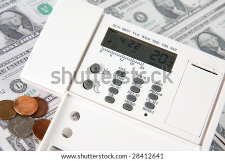 digital thermostat on money background - stock photo