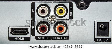 Digital video recorder and part of the black plastic background. Close-up on the part connectors. - stock photo