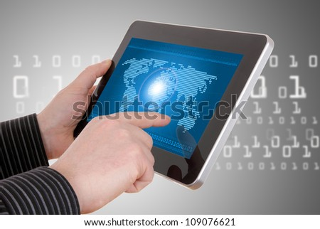 Digital world concept graphic, including digital map on tablet, in businessman's hands - stock photo