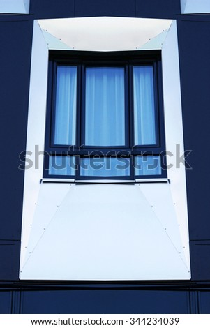 Digitally altered photo of window with substantial modification including addition of extra flaps and full symmetrization of the image. Realistic contemporary architectural detail but not real one. - stock photo