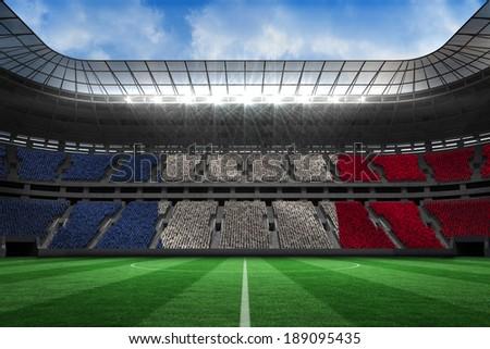 Digitally generated france national flag against large football stadium - stock photo