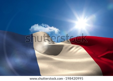 Digitally generated french national flag under sunny sky