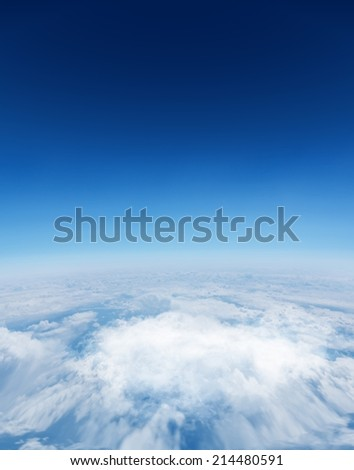 Digitally generated graphic Digitally generated Blue sky over white clouds
