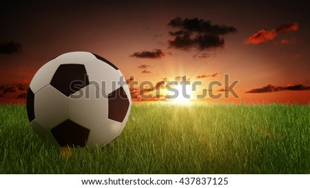 Digitally Generated Graphic of Black and White Soccer Foot Ball on Fresh Green Grass with Sun Rising in Red Morning Sky with Copy Space. 3d Rendering. - stock photo
