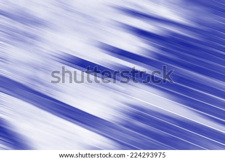 digitally generated image of  light and stripes moving fast