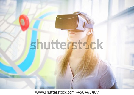 Digitally generated image of map against graphic designer using virtual reality headset in office - stock photo