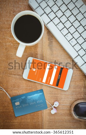 Digitally generated image of world credit card against coffee and white smartphone with headphones - stock photo