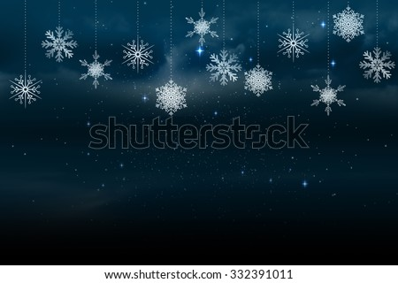 Digitally generated Snowflakes hanging against blue background - stock photo