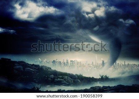 Digitally generated stormy sky with tornado over cityscape - stock photo