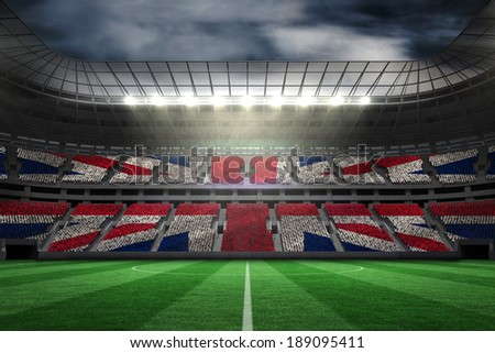 Digitally generated uk national flag against large football stadium - stock photo