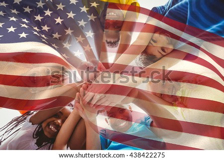 Digitally generated united states national flag against cute pupils smiling down at camera outside