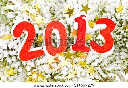 digits of the new year 2013 on the background of snow, fir branches and gold foil stars - stock photo