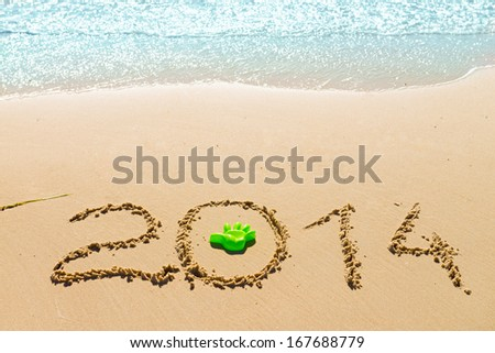 digits   2014 on the sand seashore - concept of new year and passing of time - stock photo