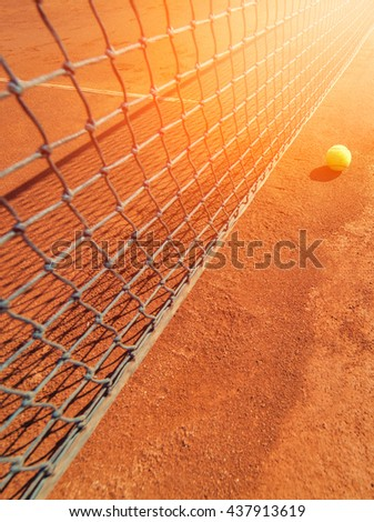 Digonal photograph of tennis ball on court - stock photo