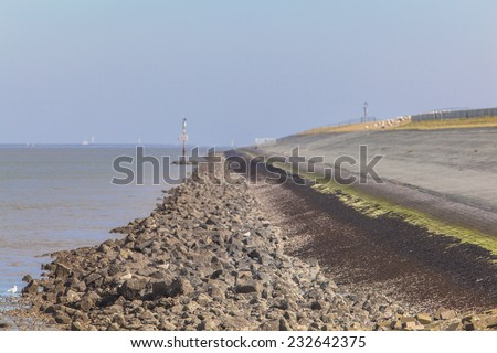 Dike along the Sea in the Netherlands to Protect against Sea Level Rising - stock photo