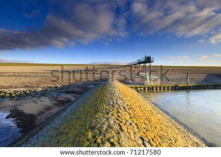 Dike in Holland at the sea - stock photo