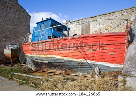 Dilapidated boat at Burghead Harbour, Highlands of Scotland. - stock photo