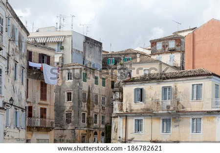 Dilapidated buildings in the backstreets of Corfu Town, Greece, where poverty leaves once grand houses to decay - stock photo