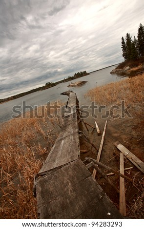 Dilapidated dock on Reed Lake in Northern Manitoba - stock photo