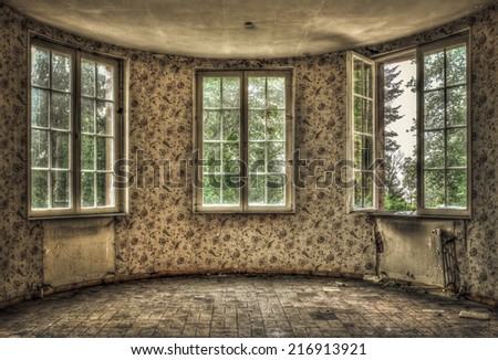 Dilapidated living room in an abandoned house - stock photo