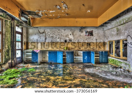 Dilapidated refectory in an abandoned building, HDR processing - stock photo