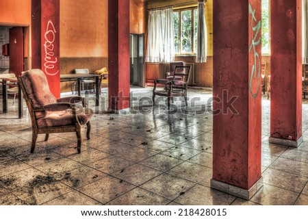 Dilapidated sitting room in an abandoned hospital, HDR - stock photo