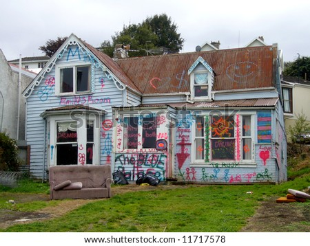 Dilapidated studen rental property, Dunedin, New Zealand - stock photo