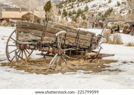 Dilapidated wagon on a winter day in a Montana ghost town - stock photo
