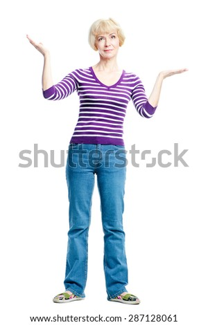 Dilemma. Full length of mature woman measuring something on the palms of her hands, making a scale with her arms. Isolated on white. - stock photo
