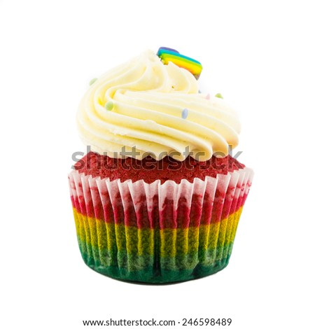 Dilicious rainbow cupcake in isolated background. - stock photo