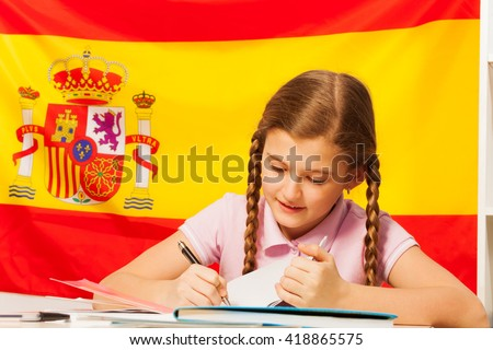Diligent teenage student learning Spanish at class - stock photo