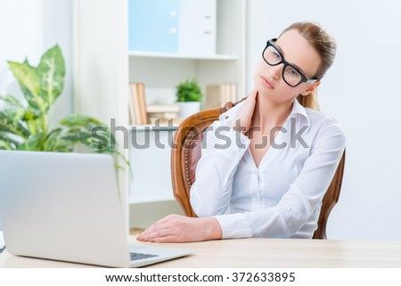 Diligent woman sitting at the table