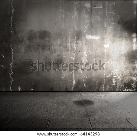 Dim and grungy stone wall room. - stock photo