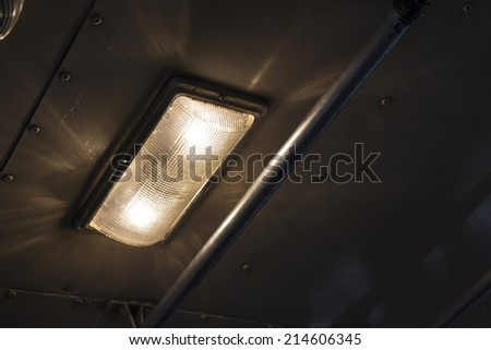 dim light from lamp and catch bar in public bus in bangkok, Thailand - stock photo