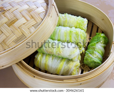 Dim Sum, a cabbage-wrapped pork, flour for better health, Chef Khun in Thailand do. - stock photo