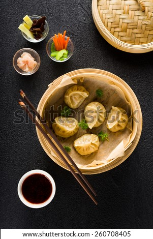 Dim sum dumplings in steamer and ingredients top view - stock photo
