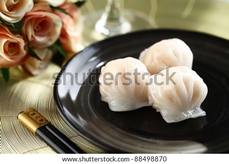 dim sum ha-gao on dish with  Chopsticks - stock photo
