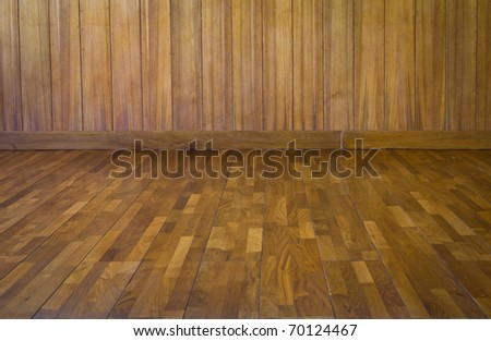Dimensional Room with a Wood Paneled Wall and Wood Floor.