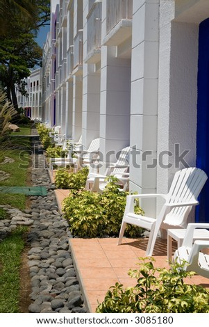 Diminishing perspective on the patios of a tropical resort - stock photo