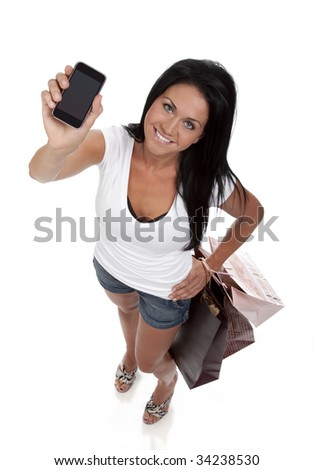 Diminishing perspective view of pretty, young brunette woman holding smart phone. White background. - stock photo