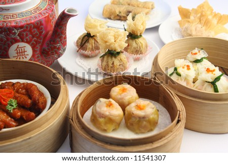 Dimsum selection in bamboo steam containers - stock photo