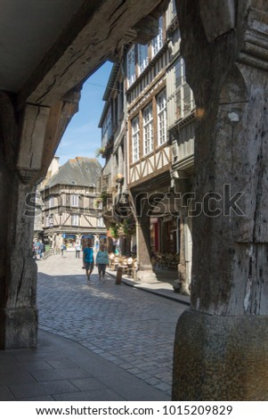 DINAN, BRITTANY, FRANCE, 15 JUNE 2015 -  medieval cobbled street and buildings in the city of Dinan, Brittany, France