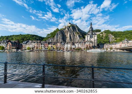 DINANT, BELGIUM - JUNE 15, 2014: The Collegiate Church of Notre-Dame is the most important landmark of Dinant, located in the Waloon region, Belgium