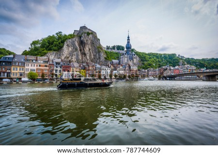 DINANT, BELGIUM - JUNE 16, 2014: The Collegiate Church of Notre-Dame is the most important landmark of Dinant, located in the Waloon region, Belgium