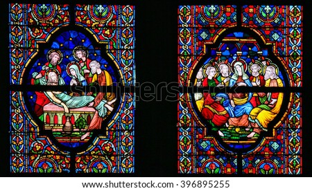 DINANT, BELGIUM - OCTOBER 16, 2011 Stained glass window depicting Jesus laid in His tomb and Mother Mary and the Apostles at Pentecost, in the Notre Dame church in Dinant, Belgium - stock photo