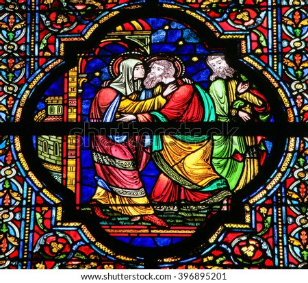DINANT, BELGIUM - OCTOBER 16, 2011 Stained glass window depicting Mother Mary and Saint Joachim in the Notre Dame church in Dinant, Belgium - stock photo