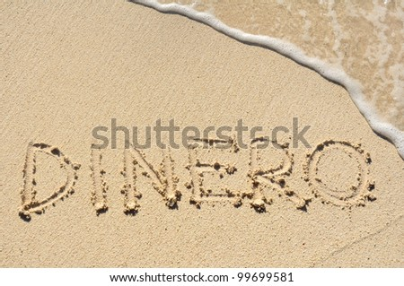 Dinero (Money) Written in the Sand on a Beach - stock photo