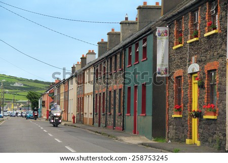 DINGLE TOWN, KERRY, IRELAND - JUNE 4, 2012: Colorful old buildings in the street of Dingle, which is a town in County Kerry, Ireland. The only town on the Dingle Peninsula. - stock photo